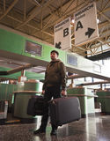 Man with baggage at the airport Royalty Free Stock Photography