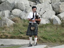 Man with Bagpipes Stock Images