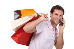 Man with bags of shopping Royalty Free Stock Photography