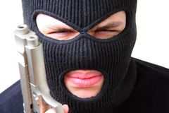 Man in balaclava with gun Stock Photography
