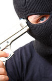 Man in balaclava with gun Stock Photo