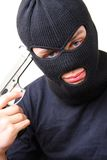 Man in balaclava with gun Stock Image