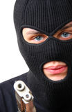 Man in balaclava with gun Royalty Free Stock Photography