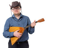 Man with balalaika in cowboy hat Royalty Free Stock Images
