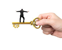 Man balance on treasure key in dollar sign shape Stock Photo