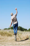 Man balancing. Mature man balancing outside on a summer day Stock Images