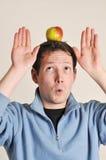Man balancing apple on head Royalty Free Stock Image