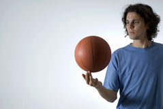 Man Balancing Basketbal-Horizontal Stock Photography