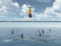 Man balancing on a board over the ocean with great white sharks Stock Photography