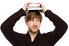 Man balancing books on his head Royalty Free Stock Photos