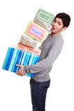 Man balancing christmas gifts Stock Image