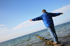 Man balancing over water Royalty Free Stock Images