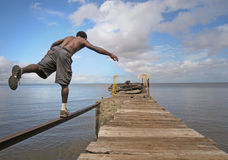 Man balancing on a pier Royalty Free Stock Photo