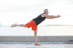 Man in a balancing pose Royalty Free Stock Photography