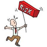 Man balancing risk metaphor Stock Photography