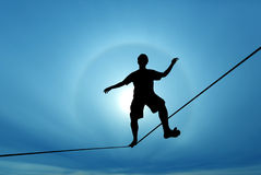 Man balancing on the rope concept of challenge and risk taking Stock Images