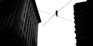 Man balancing on the rope high in the sky. Highline walker balancing on the rope concept of risk taking and challenge stock photography