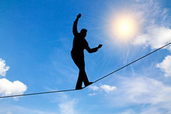 Man balancing on a rope. Illustration of a businessman walking the tightrope vector illustration