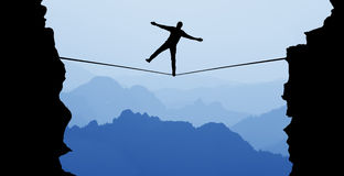 Man balancing on the rope risk taking and challenge concept. Silhouette of man balancing on the rope concept of risk taking Stock Images
