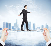 Man balancing on a tightrope concept Stock Image