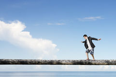 Man balancing on tree trunk high in the sky Royalty Free Stock Images