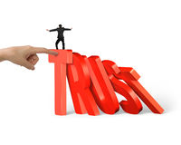 Man balancing on trust domino falling with another hand helping Royalty Free Stock Photography