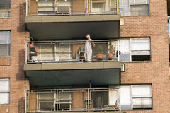 Man on balcony in t-shirt Royalty Free Stock Image