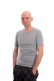 Man with bald head in gray shirt Royalty Free Stock Photos
