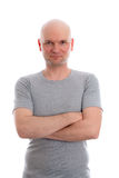 Man with bald head in gray shirt. Is looking friendly in to the camera Stock Image