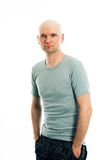 Man with bald head in gray shirt. Is looking friendly in to the camera Stock Photo