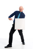 Man with bald head in is pointing to a canvas Royalty Free Stock Photography