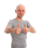 Man with bald head and thumbs up is looking friendly in to the c Royalty Free Stock Photo