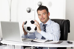 Man with ball in office stock photos