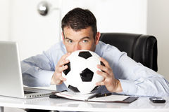 Man with ball in office Royalty Free Stock Photo
