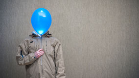 Man with the balloon Stock Images