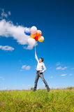 A man with balloons Stock Photos