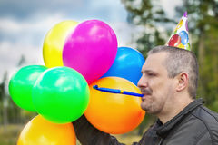 Man with balloons at outdoors Stock Image