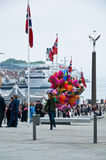 The man with balloons on the pier. At norwegian constitution day royalty free stock photography