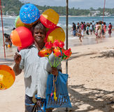 Man with baloons on poson festival Stock Photography
