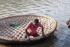 Man on the bamboo boat crossing the Kishkinda lake. Hampi, India Stock Images
