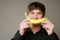 Man with banana Stock Photography