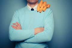 Man with bananas on his shoulder. A young man with a bunch of bananas on his shoulder Royalty Free Stock Photography