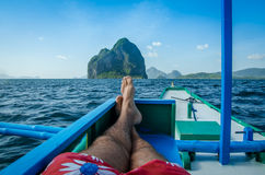 Man in banca, Inabuyatan island ahead, El, Nido, Palawan, Philippines Royalty Free Stock Photo