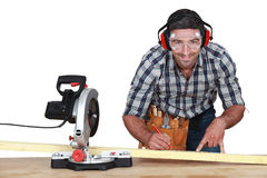 Man with band saw Royalty Free Stock Images