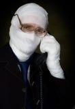 Man in bandage calling on phone Stock Photos
