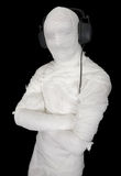 Man in bandage with ear-phones Royalty Free Stock Photography