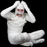Man in bandage with false eyes and mouth Royalty Free Stock Photos
