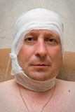 Man with bandage on head. Royalty Free Stock Photography