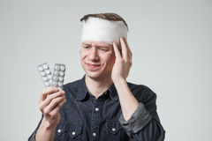 Man with bandage on his head Royalty Free Stock Photos