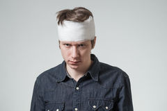 Man with bandage on his head Royalty Free Stock Image